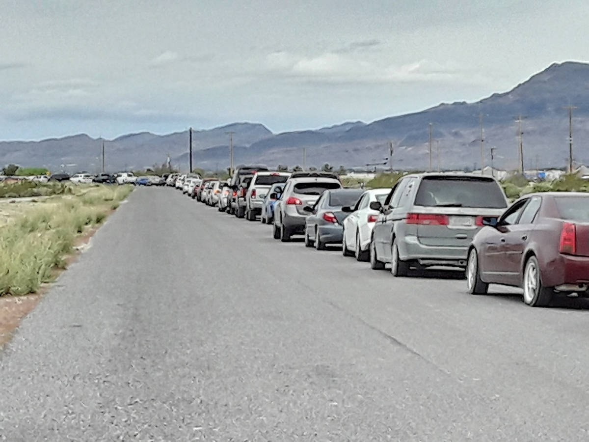 Selwyn Harris/Pahrump Valley Times Vehicles lined up from Raindance Drive off of Highway 372, f ...