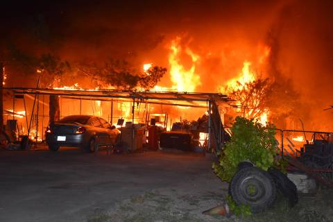 Special to the Pahrump Valley Times Pahrump fire crews battled a fierce multi-structure fire al ...