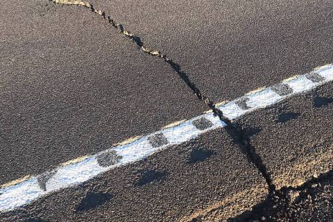 Nevada Department of Transportation Cracks in the pavement show some of the damage caused to U. ...