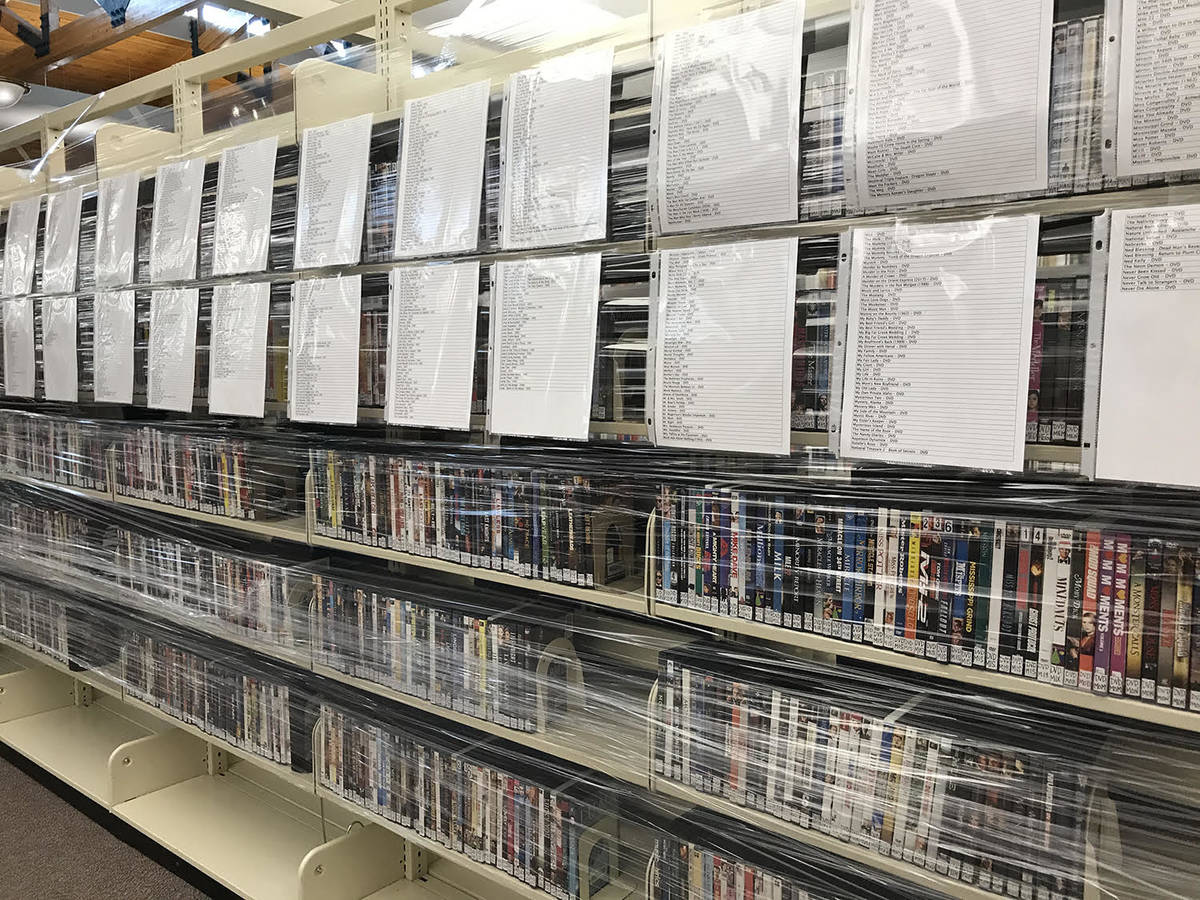 Robin Hebrock/Pahrump Valley Times The DVD section at the Pahrump Community Library has been wr ...