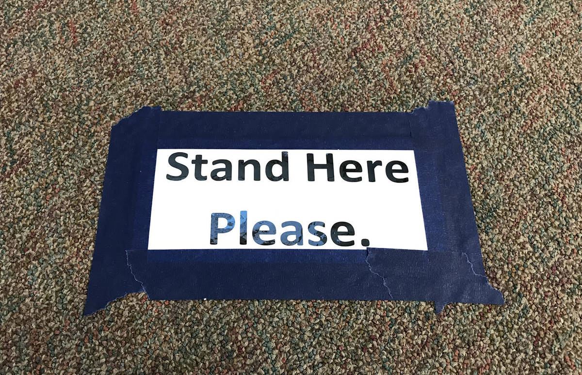 """Robin Hebrock/Pahrump Valley Times Signs reading """"stand here please"""" have been placed at six fo ..."""