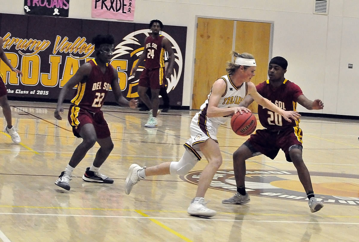 Horace Langford Jr./Pahrump Valley Times file Senior Grant Odegard brings the ball up the floor ...
