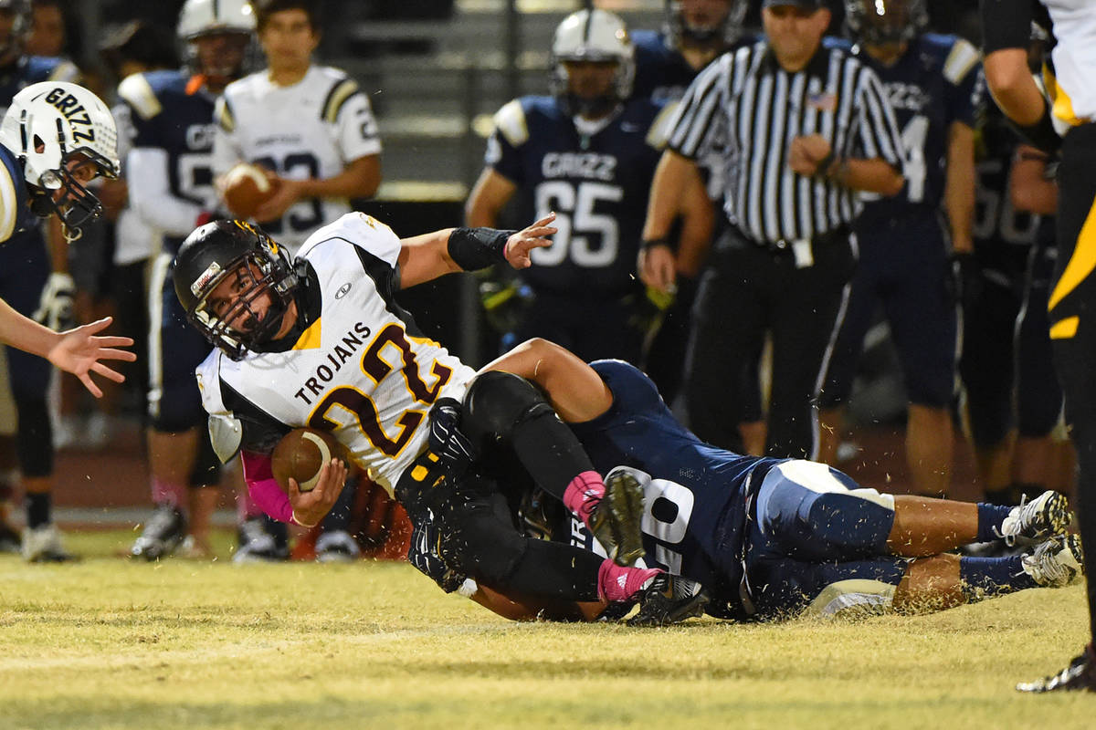Peter Davis/Pahrump Valley Times file Pahrump Valley junior Tommy Gascoigne is brought down dur ...