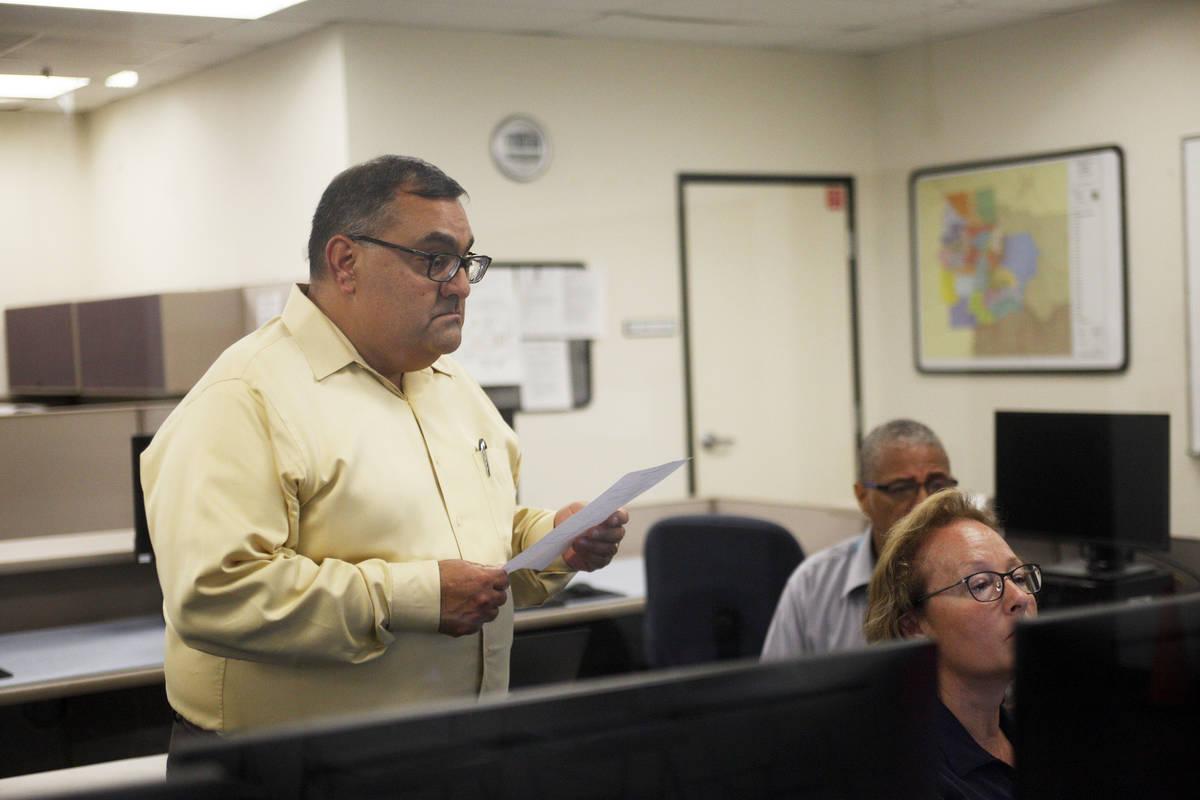 Rachel Aston Las Vegas Review-Journal Joe Gloria, the county registrar of voters, looks over Pr ...