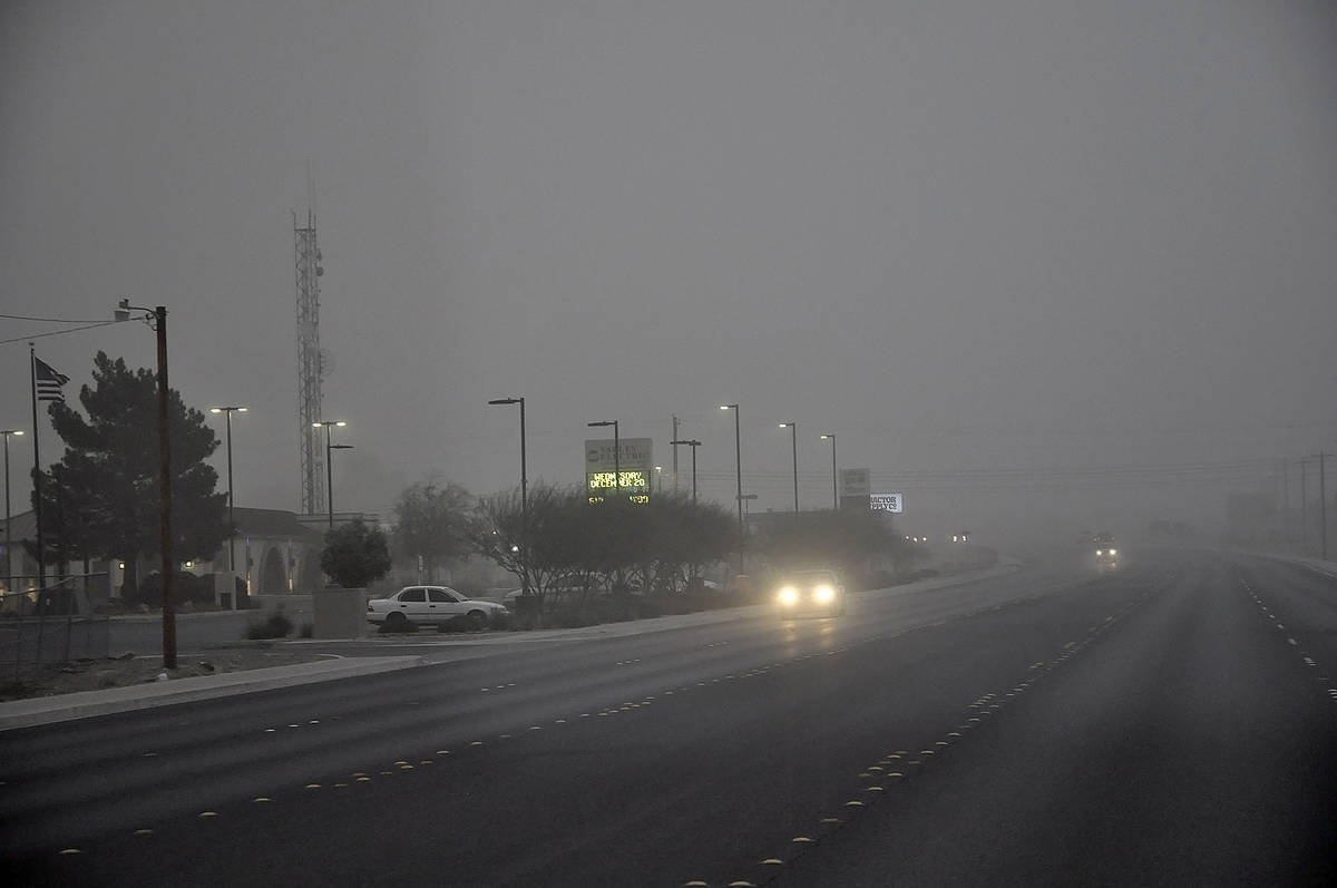 Horace Langford Jr./Pahrump Valley Times Visibility was low for drivers during a dust storm on ...