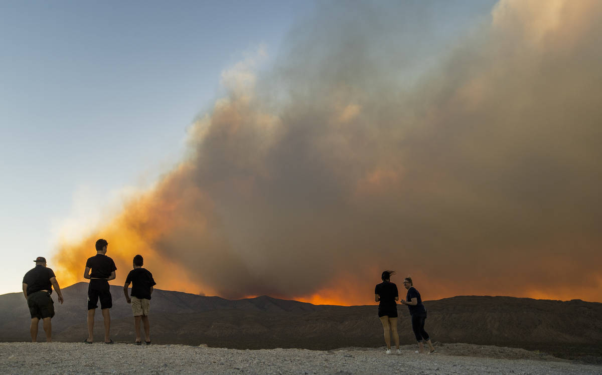 Onlookers stop to view the Mahogany Fire on Mount Charleston near a rise above Harris Spring Ro ...
