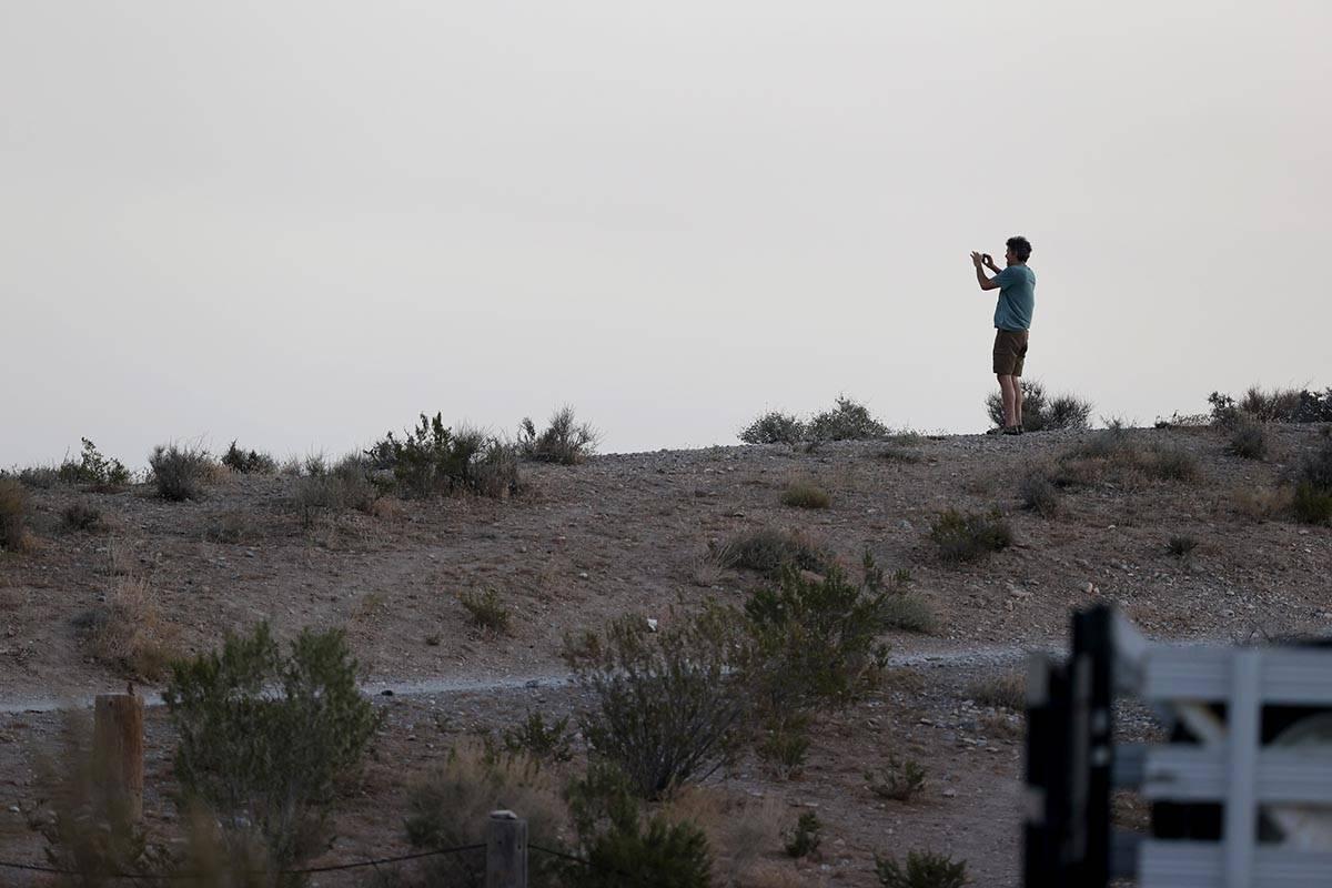 A spectator takes a photo of the Mahogany Fire on Mount Charleston near Las Vegas on Monday, Ju ...