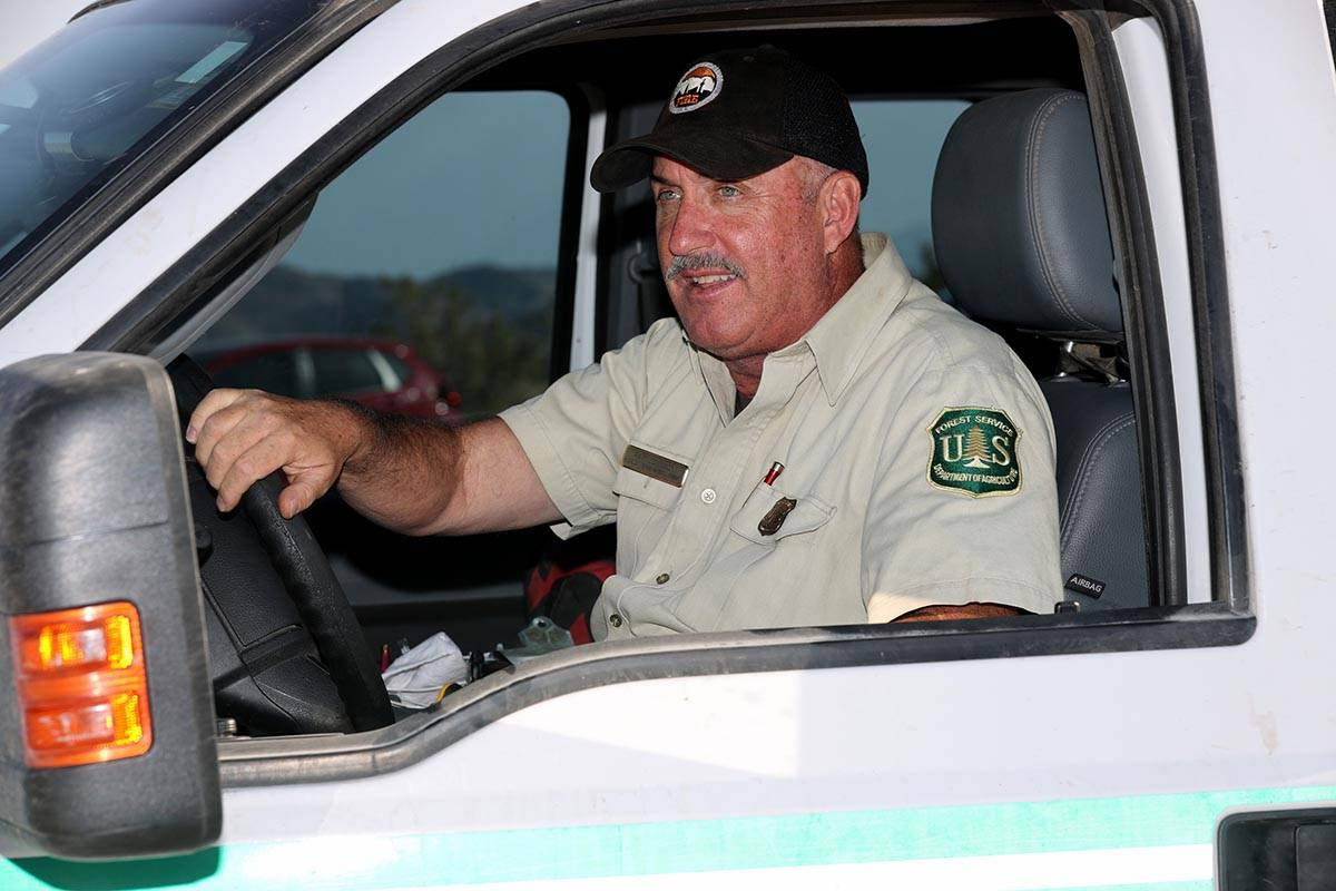 Ray Johnson, a fire prevention officer with the U.S. Forest Service, updates the news media abo ...