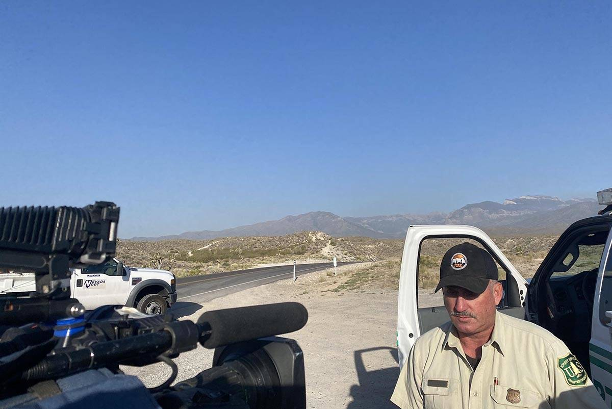 U.S. Forest Service spokesman Ray Johnson briefs media members on the wildfire at Mount Charles ...