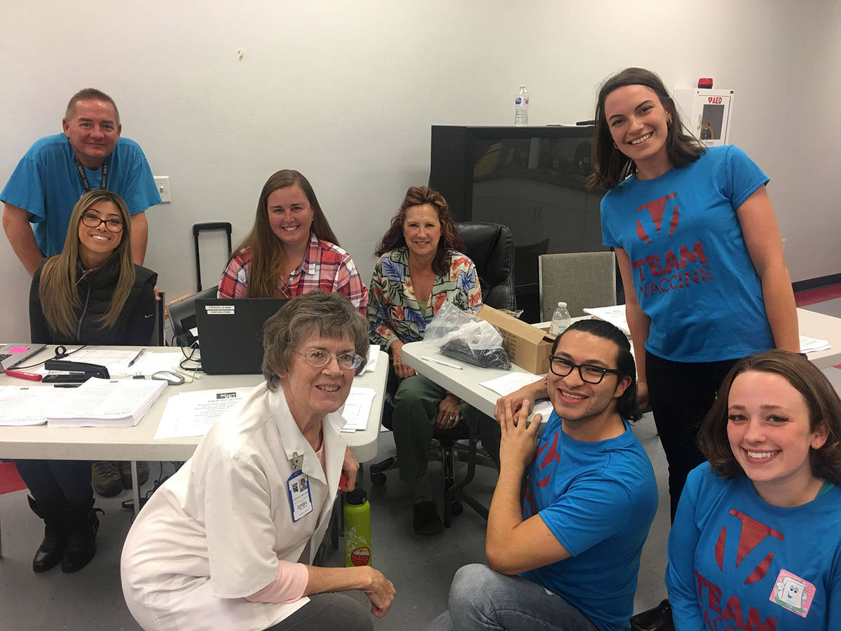 Immunize Nevada Community Health Nurse Beth Ennis is shown with Immunize Nevada staff and staff ...