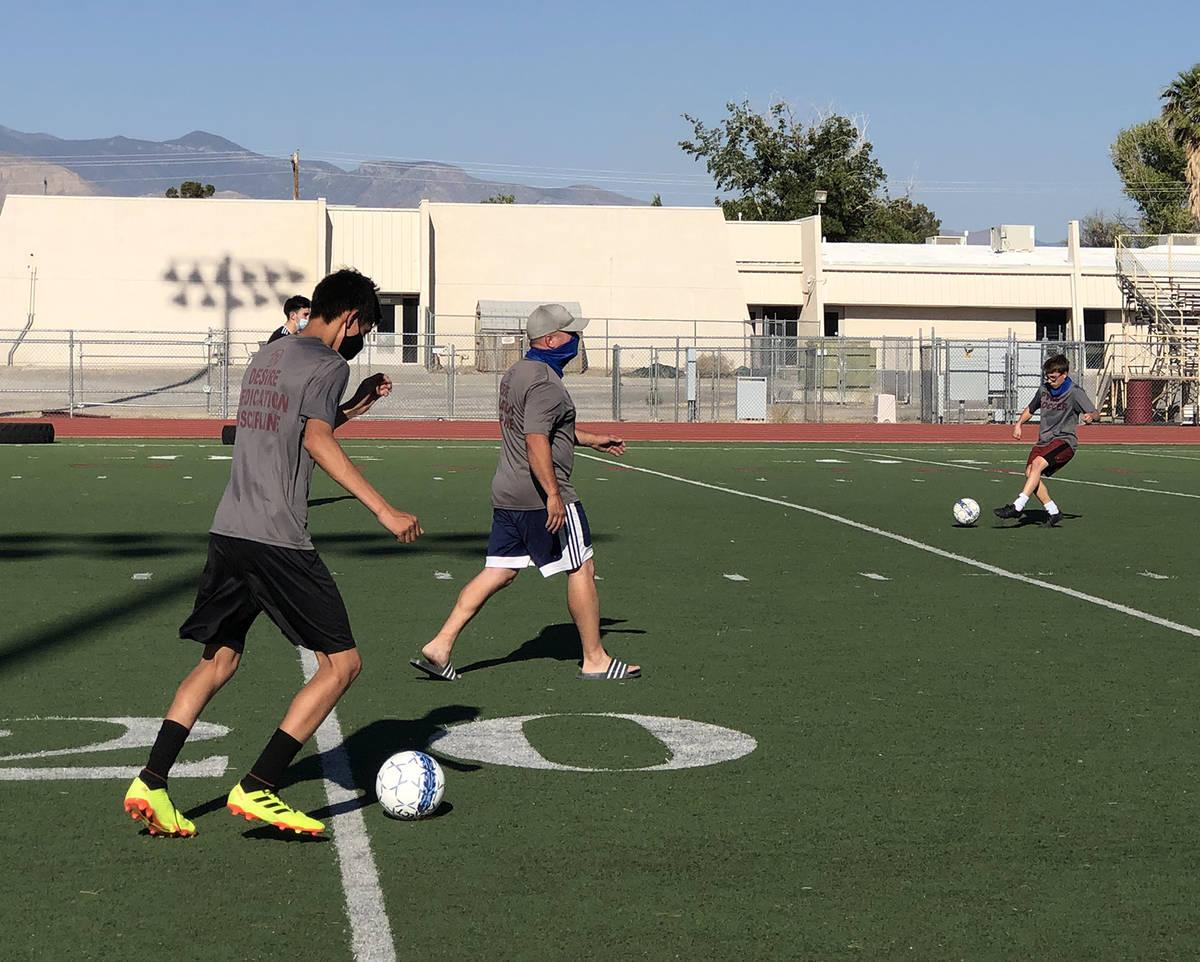 Tom Rysinski/Pahrump Valley Times Pahrump Valley High School boys soccer coach walks his team t ...