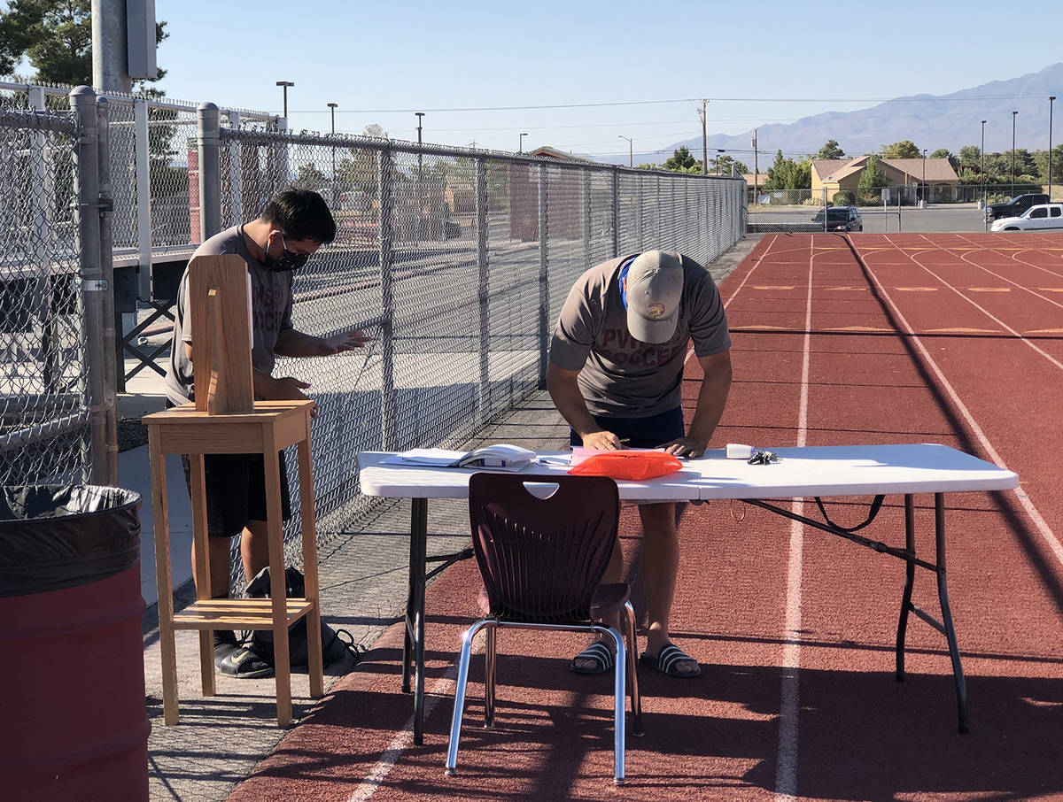Tom Rysinski/Pahrump Valley Times As one player utilizes hand sanitizer before heading out to t ...
