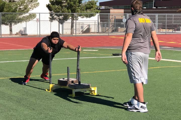 Tom Rysinski/Pahrump Valley Times A typical football practice drill shows a sign of the times: ...