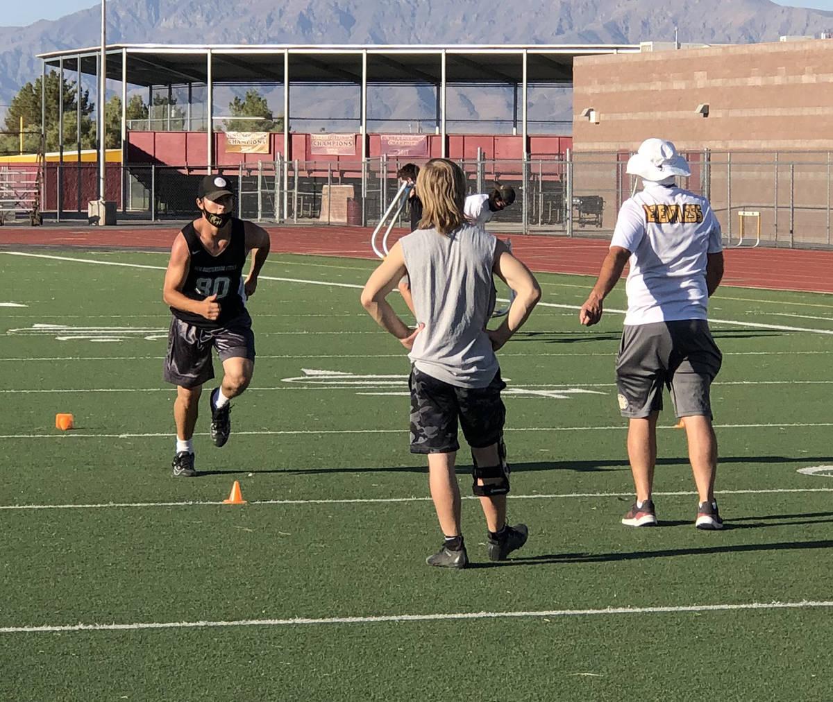 Tom Rysinski/Pahrump Valley Times Senior Tony Margiotta runs a drill as assistant coach Dan Nag ...