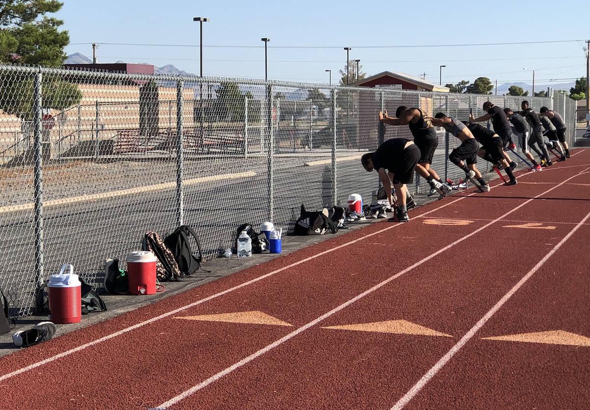 Tom Rysinski/Pahrump Valley Times Water jugs practice social distancing during football practic ...