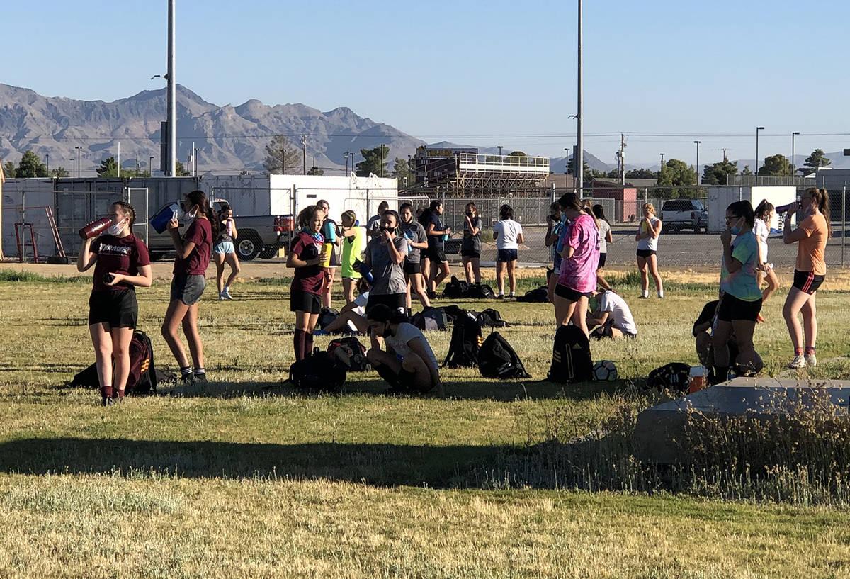 Tom Rysinski/Pahrump Valley Times Pahrump Valley High School girls soccer players stay within t ...