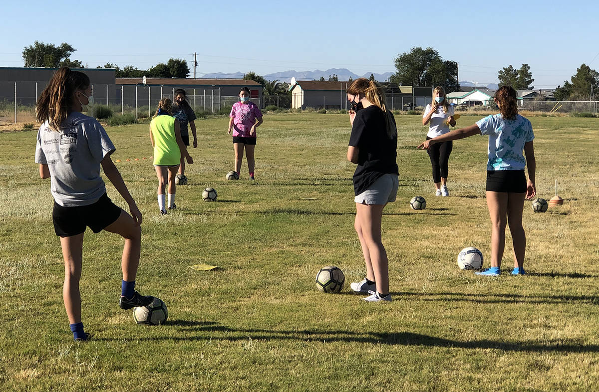 Tom Rysinski/Pahrump Valley Times Girls soccer players keep their distance during Pahrump Valle ...