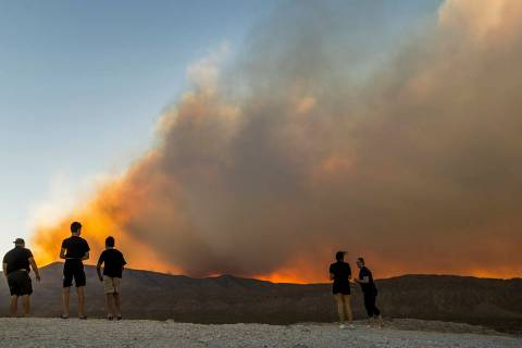 L.E. Baskow/Las Vegas Review-Journal Onlookers stop to view the Mahogany Fire on Mount Charlest ...
