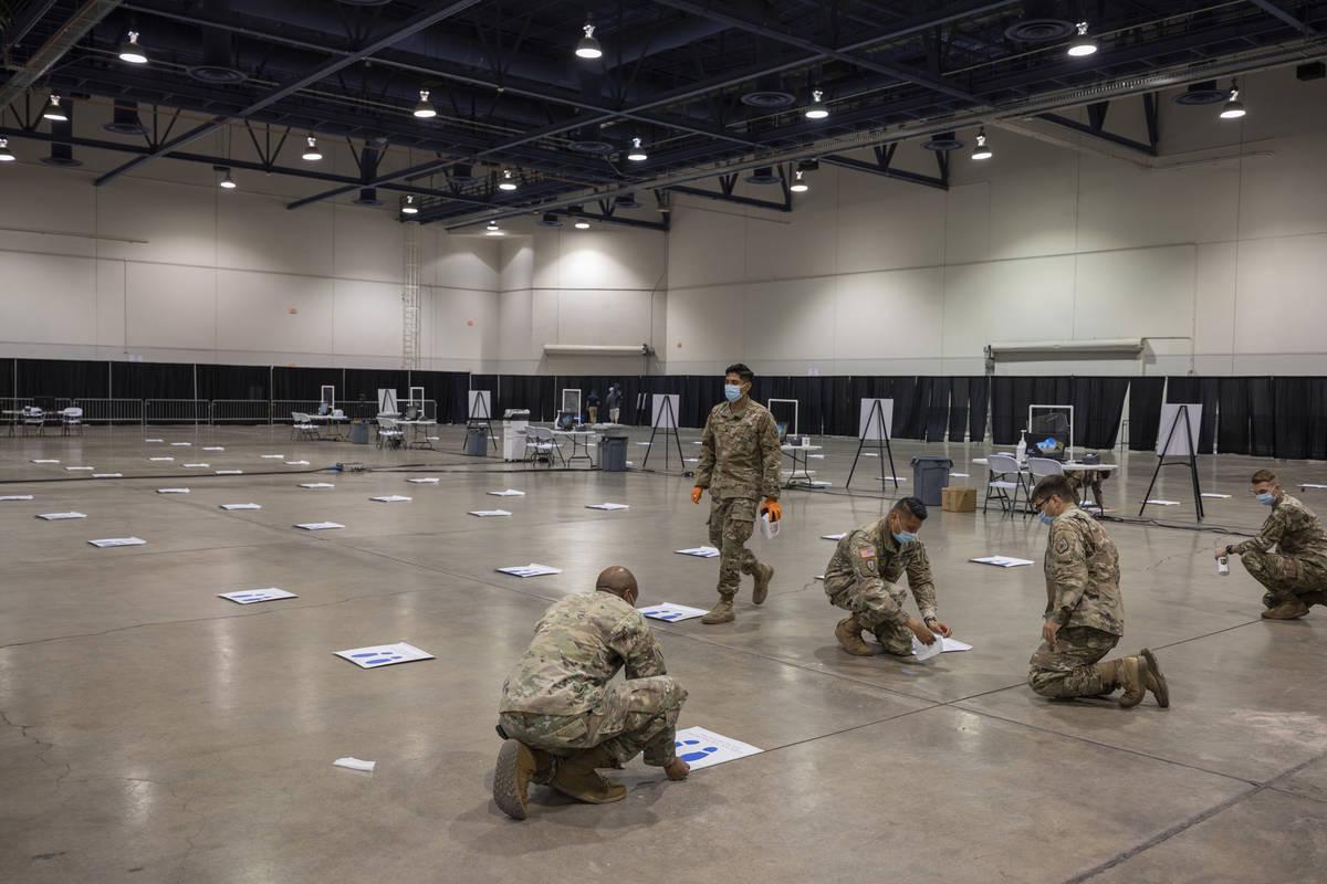 Elizabeth Brumley/Las Vegas Review-Journal The National Guard puts down 6-foot markers in prepa ...