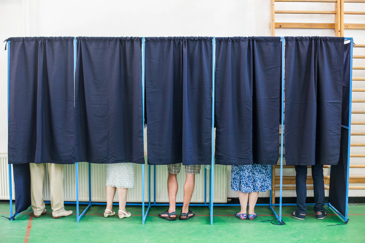Getty Images Freelance columnist and businessman Tim Burke writes about in-person voting.
