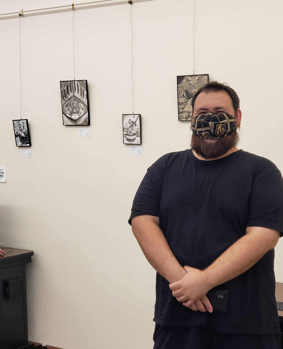 Special to the Pahrump Valley Times Mike Martin with his artwork on display at the Pahrump Comm ...