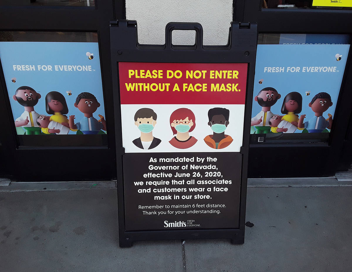 Selwyn Harris/Pahrump Valley Times Numerous signs regarding the requirement of masks are displa ...