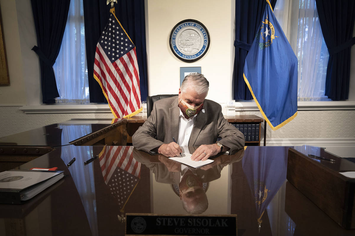 Special to the Pahrump Valley Times Gov. Steve Sisolak signs two pieces of criminal justice ref ...