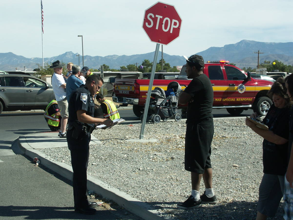 Selwyn Harris / Pahrump Valley Times - NHP Sgt. Carlos Rivera interviews witnesses following a ...