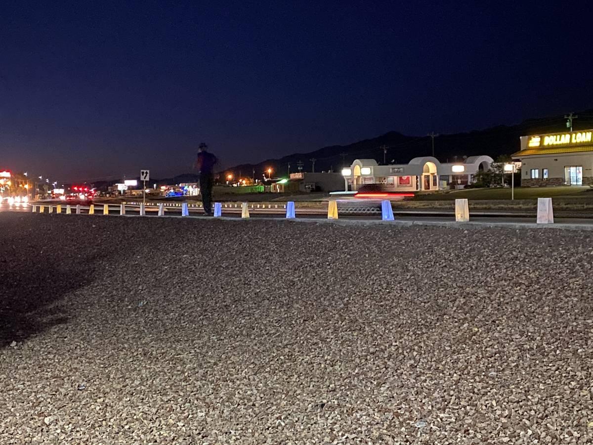 Jeffrey Meehan/Pahrump Valley Times Area residents walk along Highway 160 alongside a long row ...