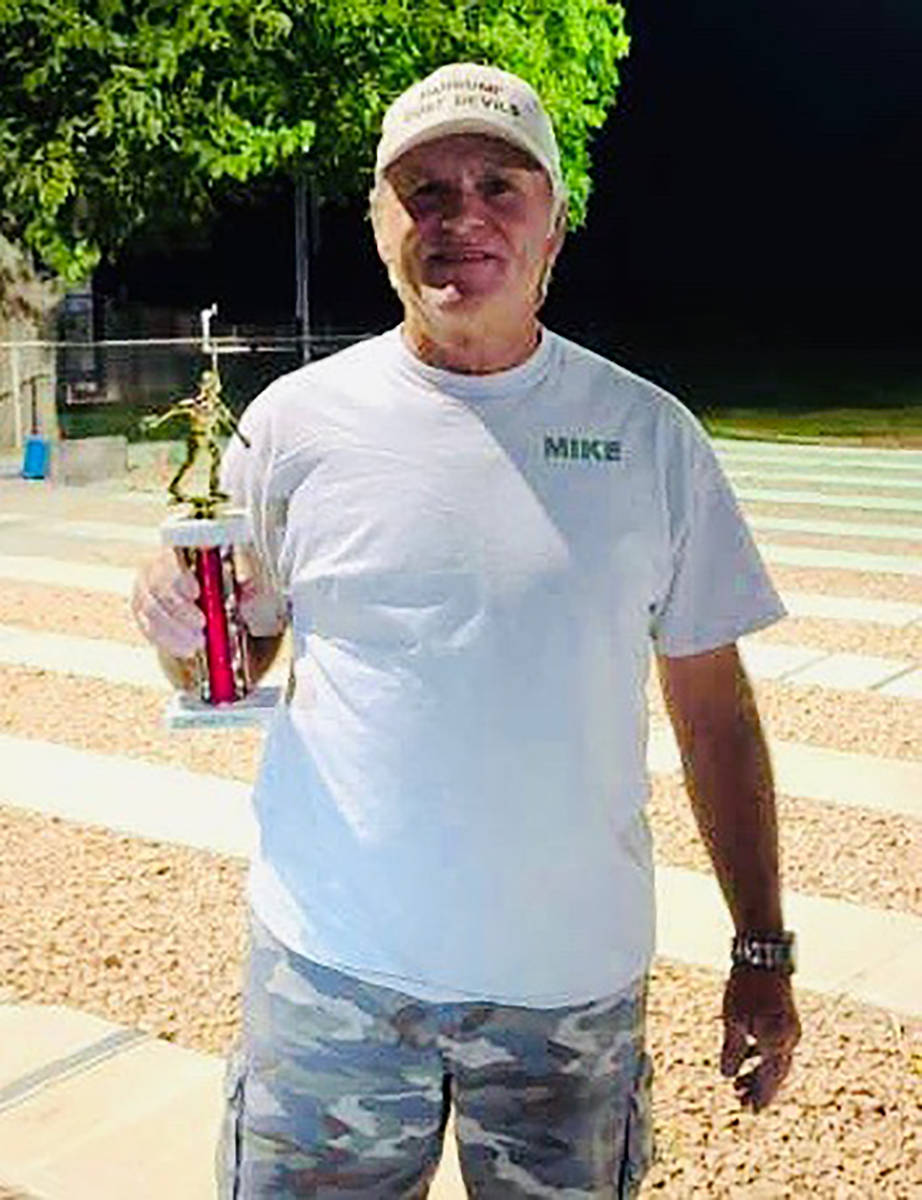 Kim Dilger/Special to the Pahrump Valley Times Tournament host Mike Nicosia fell to Lathan Dilg ...