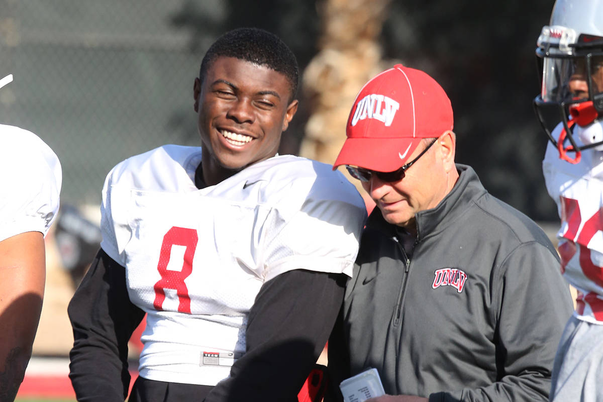 Bizuayehu Tesfaye/Special to the Pahrump Valley Times UNLV running back Charles Williams chats ...