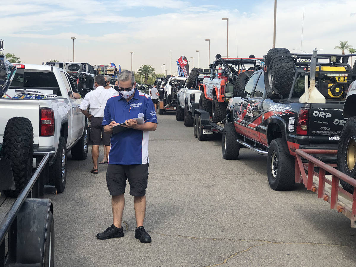 Tom Rysinski/Pahrump Valley Times Vehicles form two lines, at least while they have enough spac ...