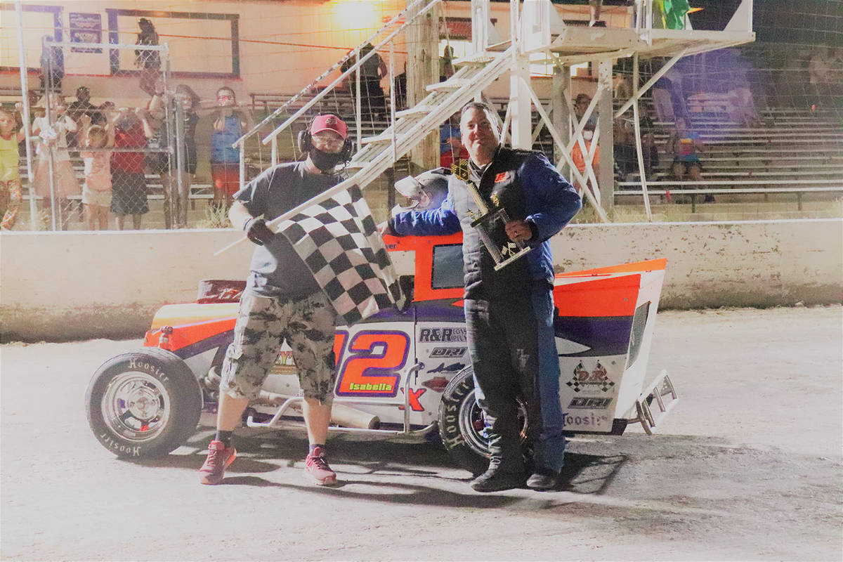 Digital Storm Photography/Special to the Pahrump Valley Times John Isabella with track flagman ...