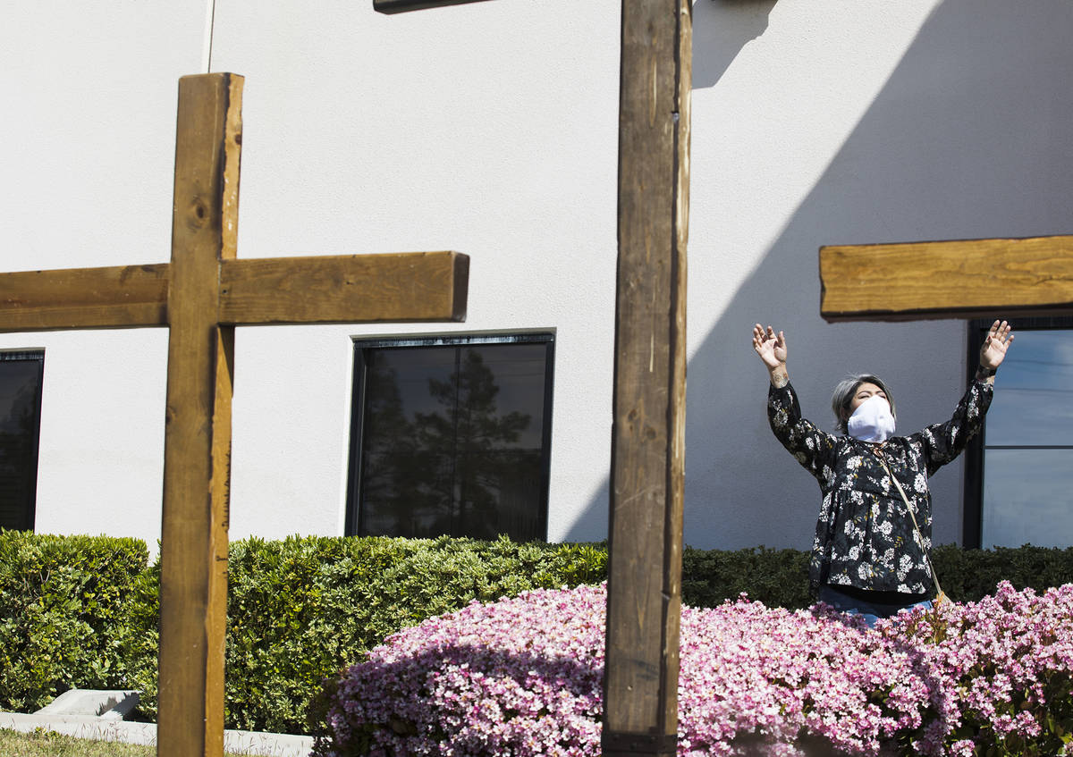 Norma Urrabazo worships from the side of the stage at an Easter service in the parking lot at I ...