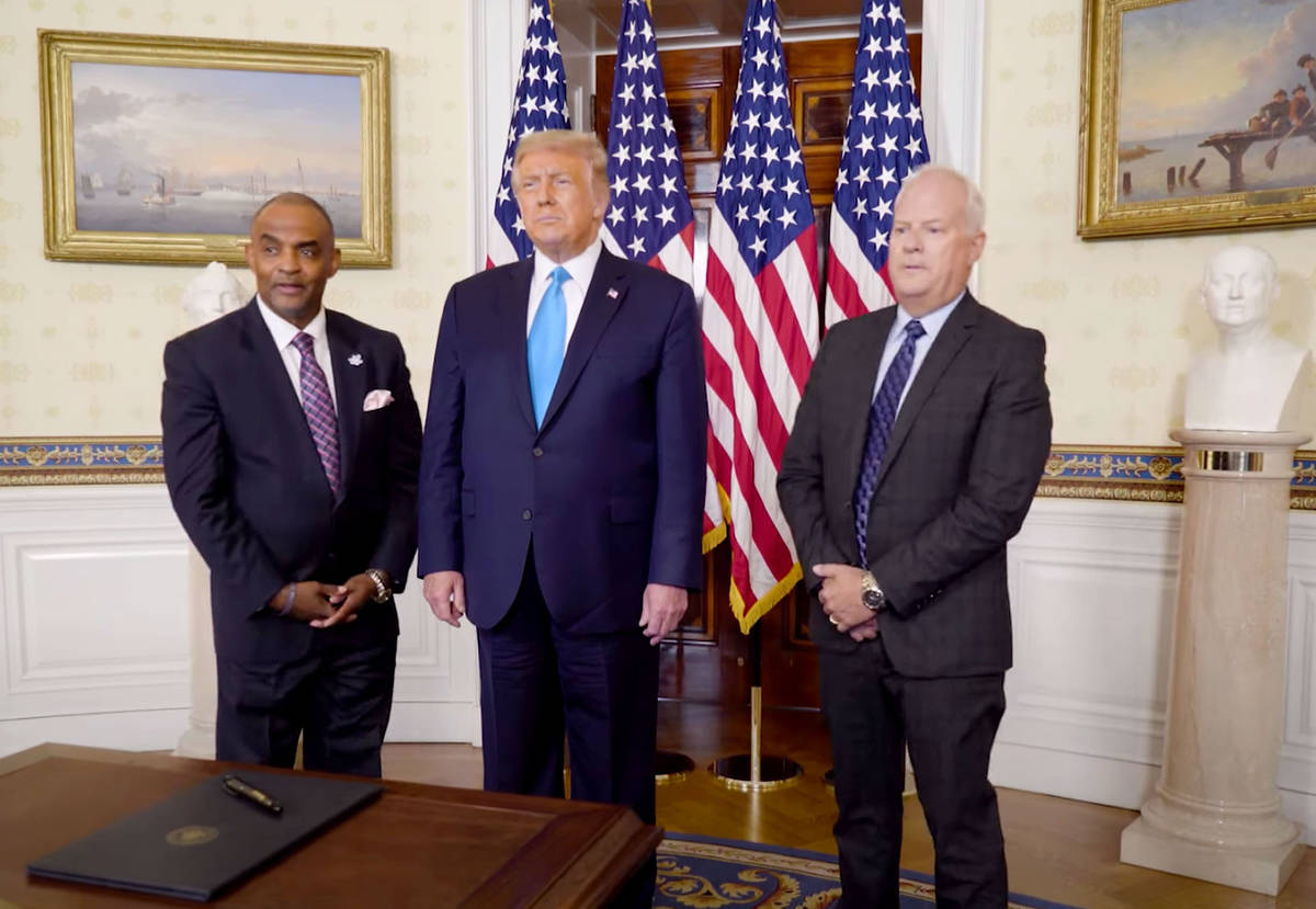 This image from video shows Nevada bank robber Jon Ponder, left, President Trump, center, and f ...