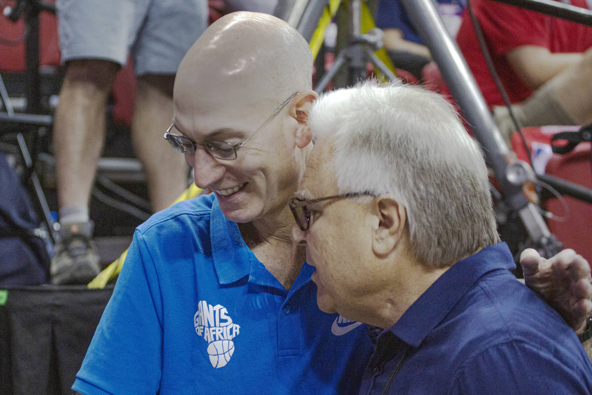 NBA Commissioner Adam Silver talks to Summer League Executive director Warren LeGarie during th ...