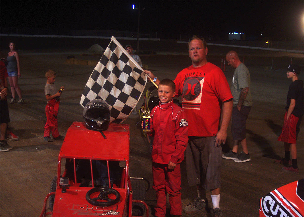 Pahrump Valley Times file Dusty Park with Booey McClard after McClard won a mini dwarf race in ...