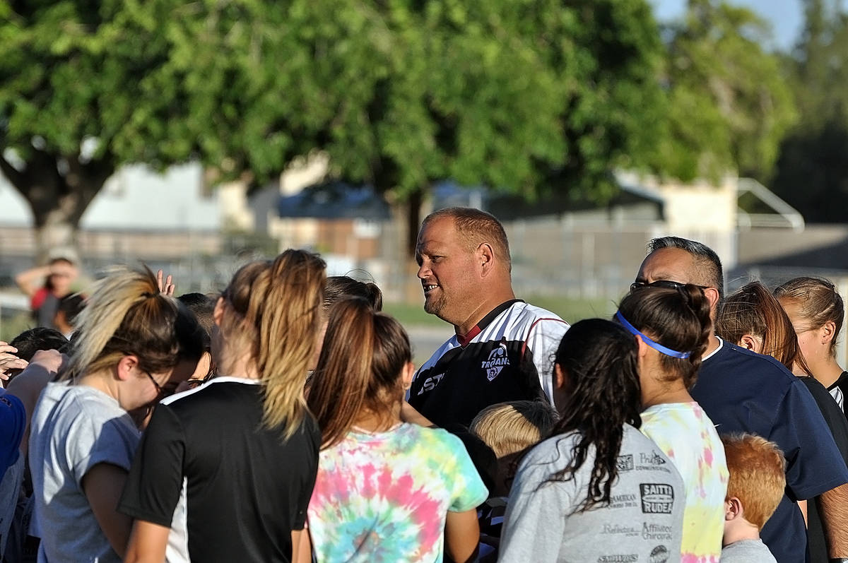 Horace Langford Jr./Pahrump Valley Times Dusty Park is surrounded by young soccer players durin ...