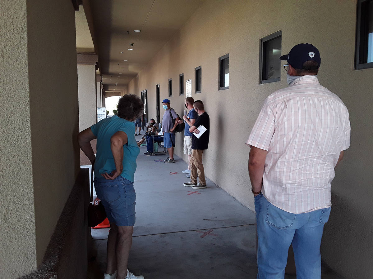 Selwyn Harris/Pahrump Valley Times Many Pahrump DMV customers decried the long wait times in or ...