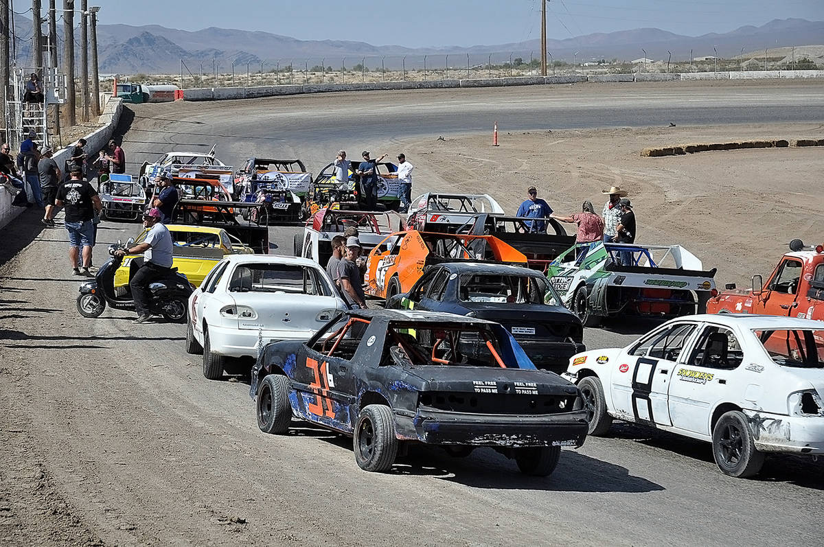 Horace Langford Jr./Pahrump Valley Times Cars line up to participate in the five memorial laps ...