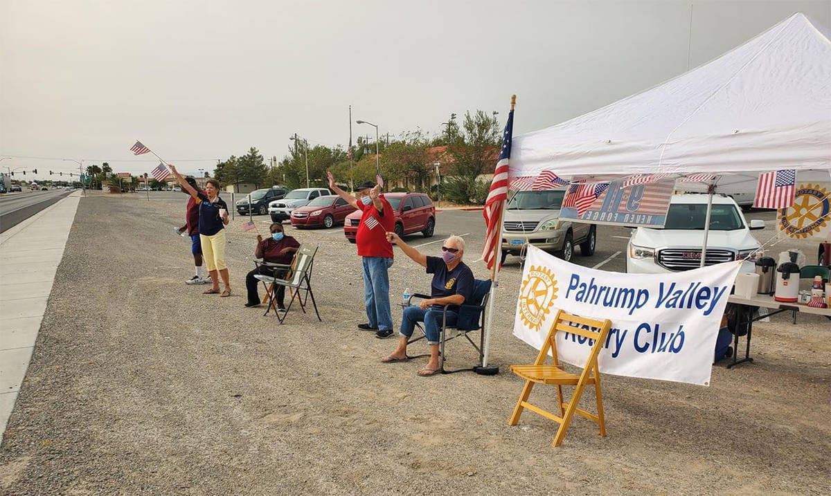 Photo courtesy of Pahrump Rotary Club Members of the Pahrump Valley Rotary Club lined north Hig ...