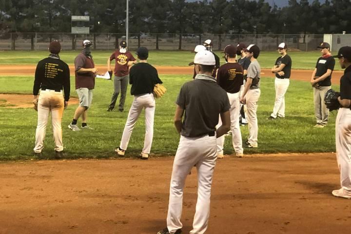 Tom Rysinski/Pahrump Valley Times Coach Brian Hayes talks to players on Pahrump's club baseball ...