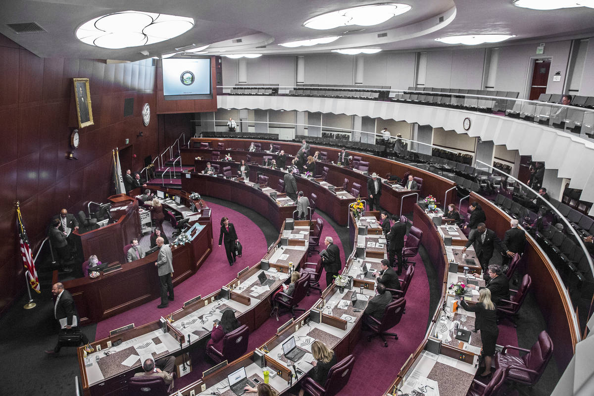 Benjamin Hager/Las Vegas Review-Journal Members of the assembly file out of chambers during the ...
