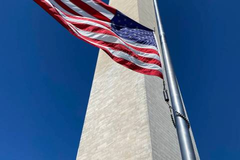 Getty Images An American flag flies half-staff at the Washington Monument in honor of Ruth Bad ...