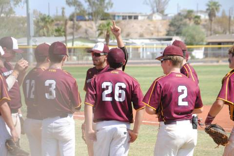 Charlotte Uyeno/Pahrump Valley Times Jalen Denton rallies his Trojans Gold teammates during the ...