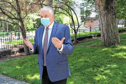 A masked Gov. Steve Sisolak speaks to reporters. (Bill Dentzer/Las Vegas Review-Journal)