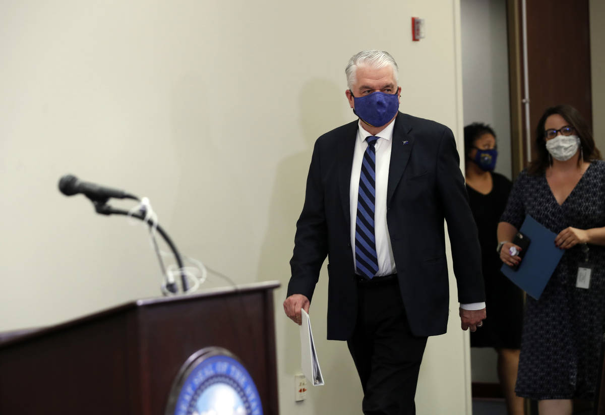 Nevada Gov. Steve Sisolak arrives for a news conference at the Grant Sawyer State Building in L ...