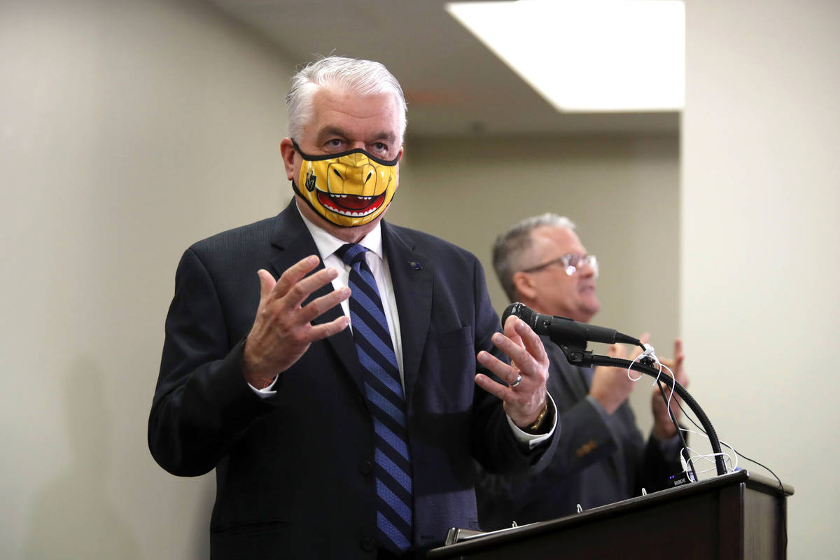 Nevada Gov. Steve Sisolak responds to a question during a news conference at the Grant Sawyer S ...