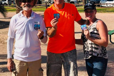 Jim Hatch/Special to the Pahrump Valley Times Tournament champion Lathan Dilger, center, is fla ...