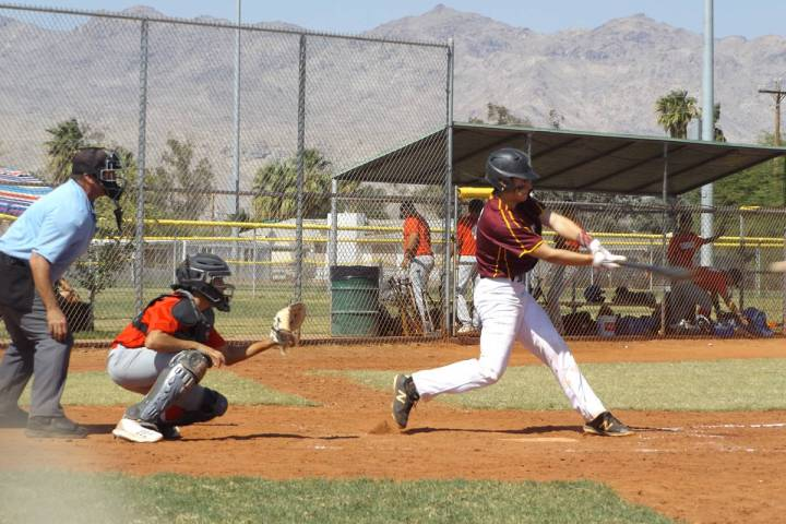 Charlotte Uyeno/Pahrump Valley Times Catcher Coby Tillery connects for a hit for Trojans Gold d ...